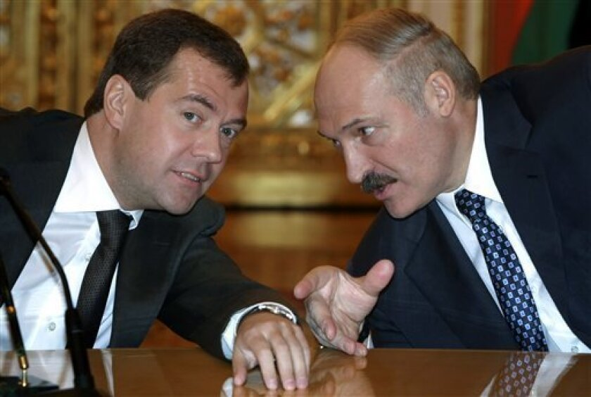 Russian President Dmitry Medvedev, left, and Belarusian President Alexander Lukashenko seen during a meeting at the Kremlin in Moscow, Tuesday, Feb. 3, 2009. Russia and Belarus were set to boost their military ties Tuesday by signing a deal to form a joint air defense system. (AP Photo/RIA-Novosti, Mikhail Klimentyev, Presidential Press Service)
