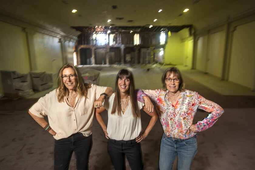 Maggie Mackay, center, Patty Polinger, left, and Cathy Tauber, right, inside the new location for Vidiots.