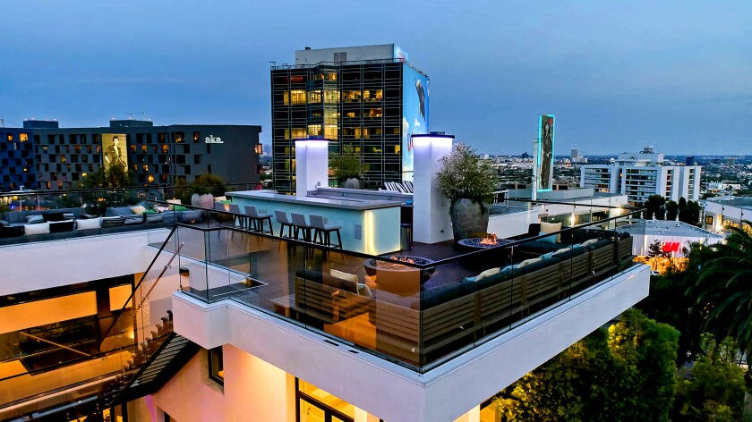 The Sunset Strip Home of the Week is geared for outdoor living with multiple terrace patios and a rooftop deck with a bar.