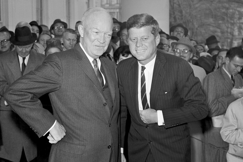 FILE - In this Dec. 6, 1960, file photo, President Dwight Eisenhower poses with President-elect John F. Kennedy at the White House in Washington, before a private conference. Researchers at the John F. Kennedy Presidential Library and Museum in 2020 have found a cache of letters from Americans objecting to JFK's embrace of cocktails at White House events. The letters shed new insight into Eisenhower's handoff to Kennedy early in 1961, and the strikingly different attitudes that people held about alcohol at official functions. (AP Photo, File)