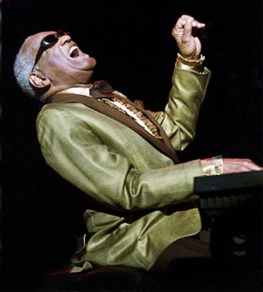 Ray Charles is shown in 2002 at the Universal Amphitheatre.