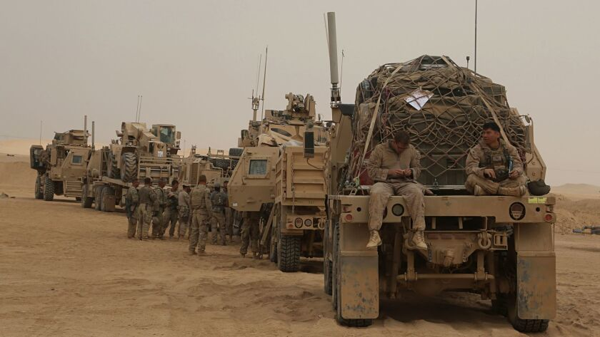 In this Tuesday, Nov. 7, 2017 photo, U.S. Marines prepares to build a military site in western Anba