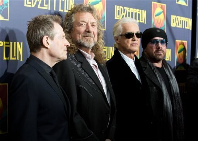 """FILE - This Oct. 9, 2012 file photo shows musicians, from left, John Paul Jones, Robert Plant, Jimmy Page and Jason Bonham at the""""'Led Zeppelin: Celebration Day"""" premiere in New York. CBS' """"60 Minutes"""" webcast reported Monday, May 6, 2013, that former President Clinton was enlisted to ask the Briti"""