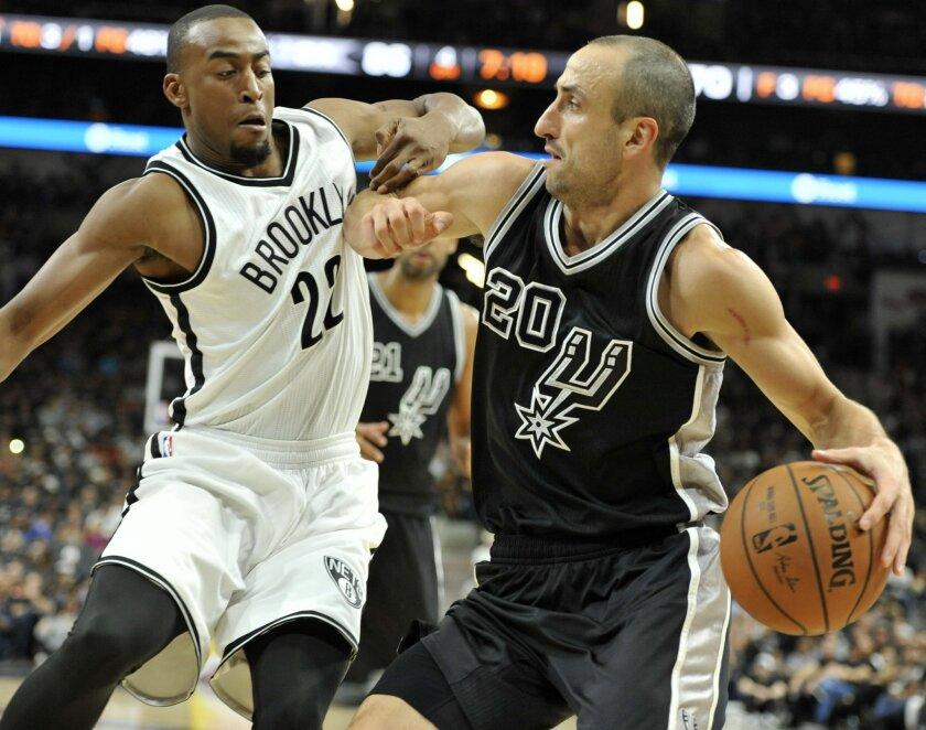 Brooklyn Nets guard Markel Brown (22) defends San Antonio Spurs guard Manu Ginobili, of Argentina, in the second half of an NBA basketball game Friday, Oct. 30, 2015, in San Antonio. (AP Photo/Bahram Mark Sobhani)