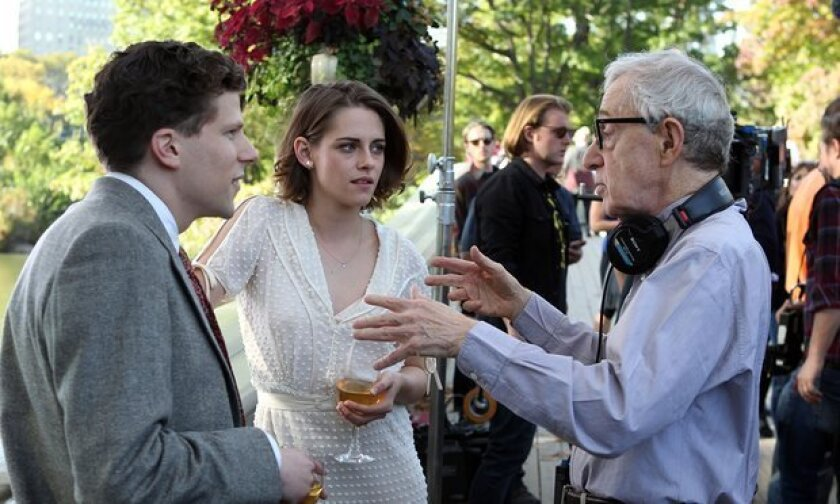 """Kristen Stewart and Jesse Eisenberg take direction from Woody Allen on the set of """"Cafe Society"""""""