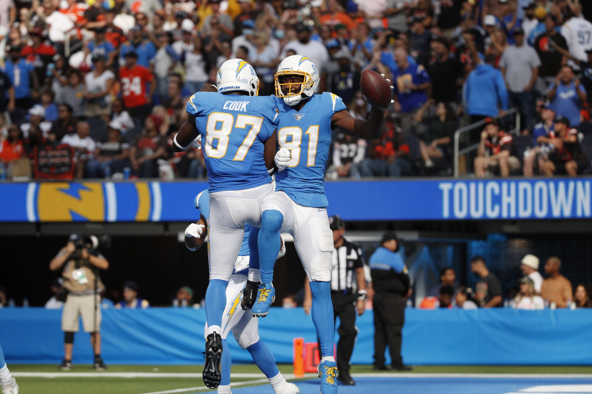 Chargers wide receiver Mike Williams celebrates with tight end Jared Cook after scoring a fourth-quarter touchdown.