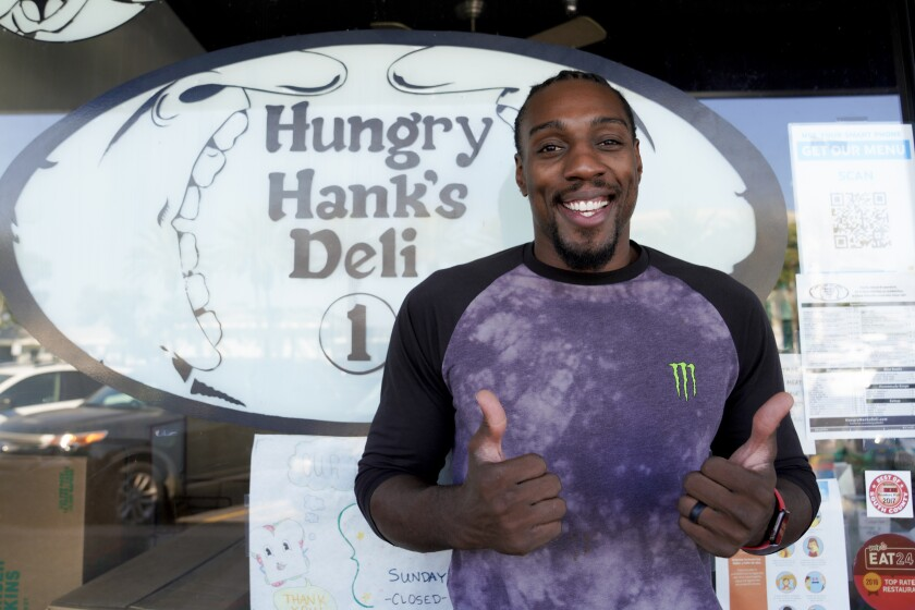 Bellator's former light heavyweight champion Phil Davis, shown outside his Chula Vista business last September