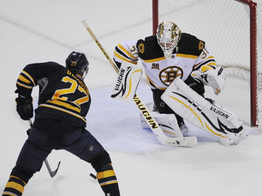 Buffalo Sabres' Matt D'Agostini (27) moves in to score the game-winning goal on Boston Bruins' Chad Johnson (30) during the overtime session of an NHL hockey game in Buffalo, N.Y., Wednesday, Feb. 26, 2014. Buffalo won 5-4. (AP Photo/Gary Wiepert)