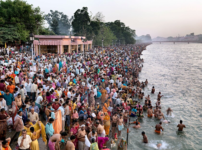 """Kumbh Mela #1, Haridwar, India,"" 2010, by Edward Burtynsky. Millions of Indians bathe in a river for the Maha Kumbh Mela religious pilgrimage."