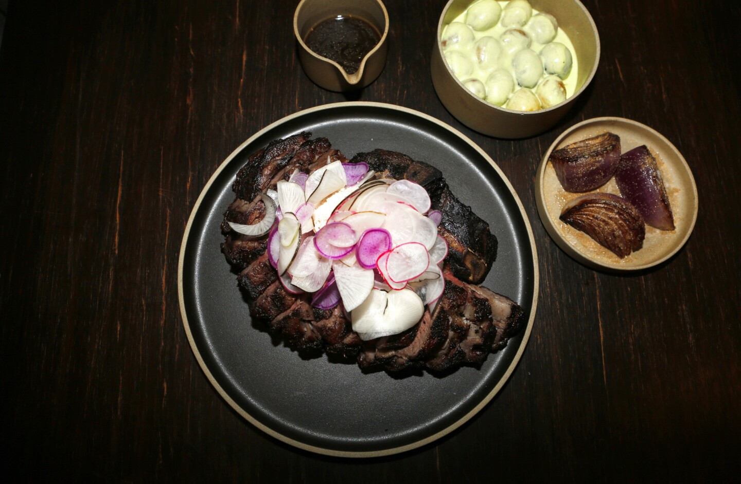The Holstein rib-eye at the Koreatown restaurant Here's Looking at You is a wonderful piece of meat, dry-aged for 30 days and enhanced with melted radish butter.