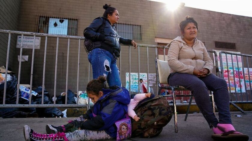 Claudia Hernandez (left) along with her six-year old daughter, Angelina and friend Fernanda Zuniga (right) were among the last group that was evicted from the Contra Viento y Marea, temporary shelter in Tijuana. Hernandez is trying to cross into the U.S.