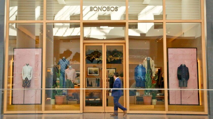 A man walks by the Bonobos Guideshop in New York's Financial District in March.