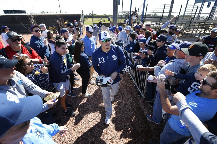 Padres infielder Manny Machado signs autographs after a spring training practice on Feb. 23.