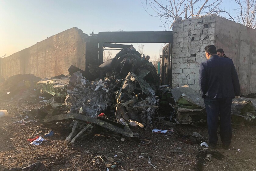 Debris from a plane crash on the outskirts of Tehran.