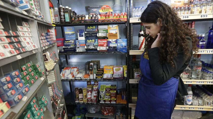 In this May 17, 2018 photo, Miriam Zouzounis looks through a selection of tobacco products while int