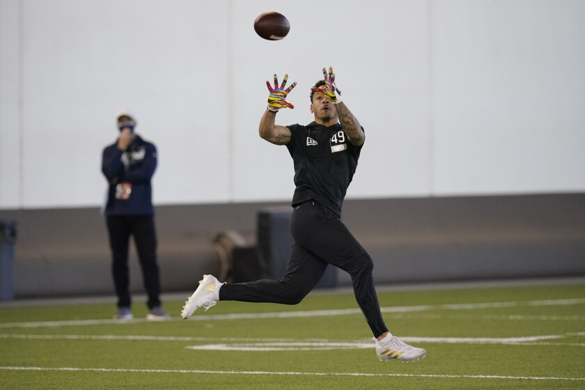 Oklahoma State wide receiver Tylan Wallace catches a pass at NFL pro day, Thursday, April 1, 2021, in Stillwater, Okla. (AP Photo/Sue Ogrocki)