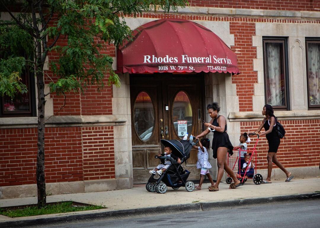People walk past Rhodes Funeral Service
