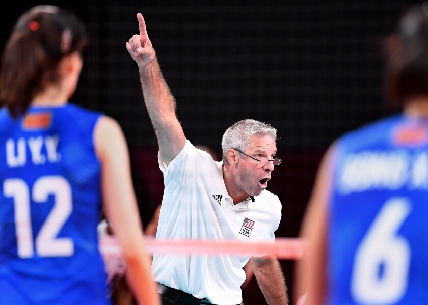 U.S. volleyball coach Karch Kiraly talks to his team and points up