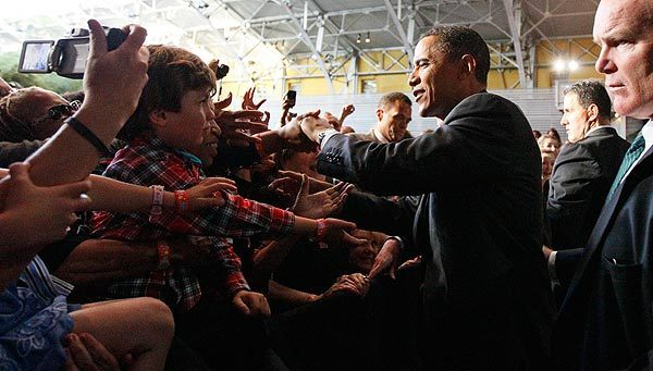 President Obama shakes hands at a fundraiser for the Democratic National Committee and Sen. Barbara Boxer at the California Science Center in Los Angeles.