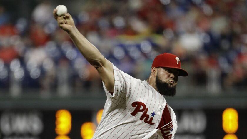 FILE - In this Aug. 29, 2018, file photo, Philadelphia Phillies' Luis Garcia pitches to a Washington