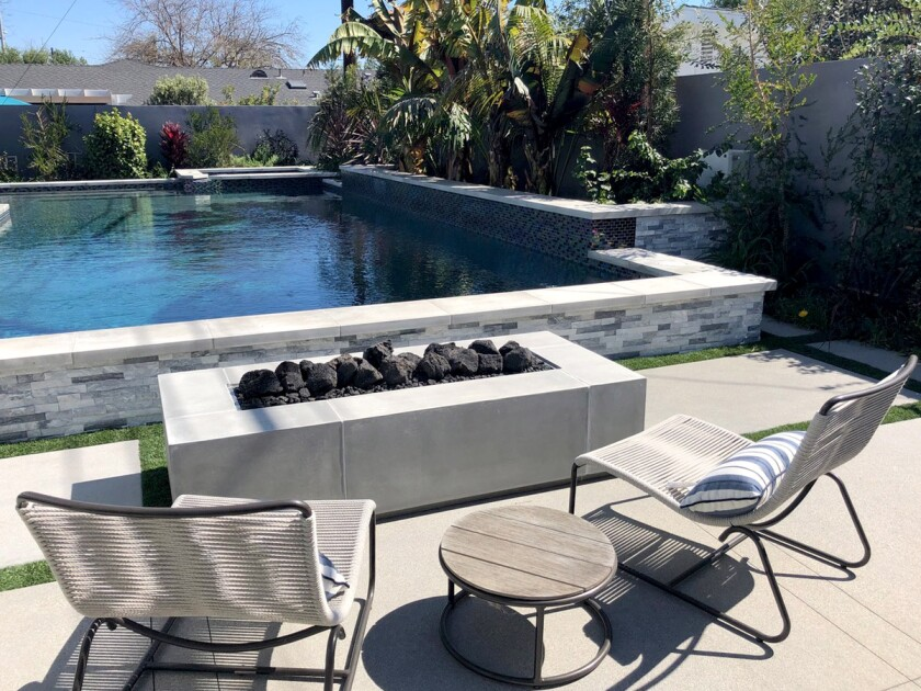 An elevated pool and fire pit on Rossmoor's Spring Garden Tour and Outdoor Marketplace.