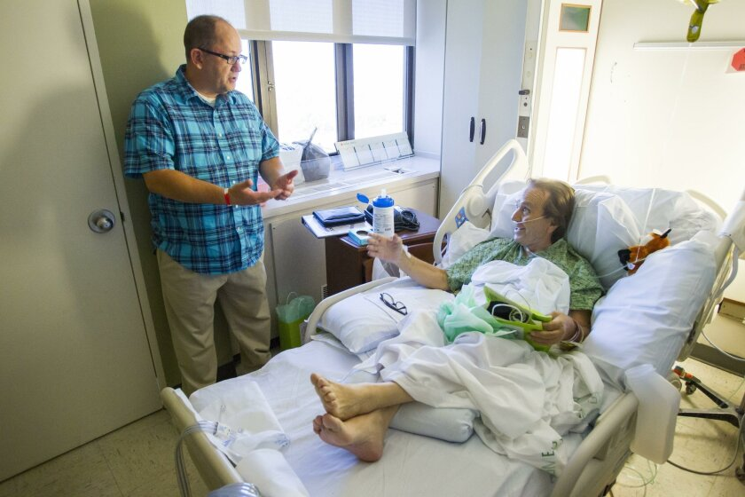 """Brian Tieber, a Stage 4 head and neck cancer survivor, founded """"Hope and Victory Cancer Care,"""" visits with Sharp Chula Vista patient Francisco Enriquez, 66, who was recently diagnosed with small cell lung cancer."""