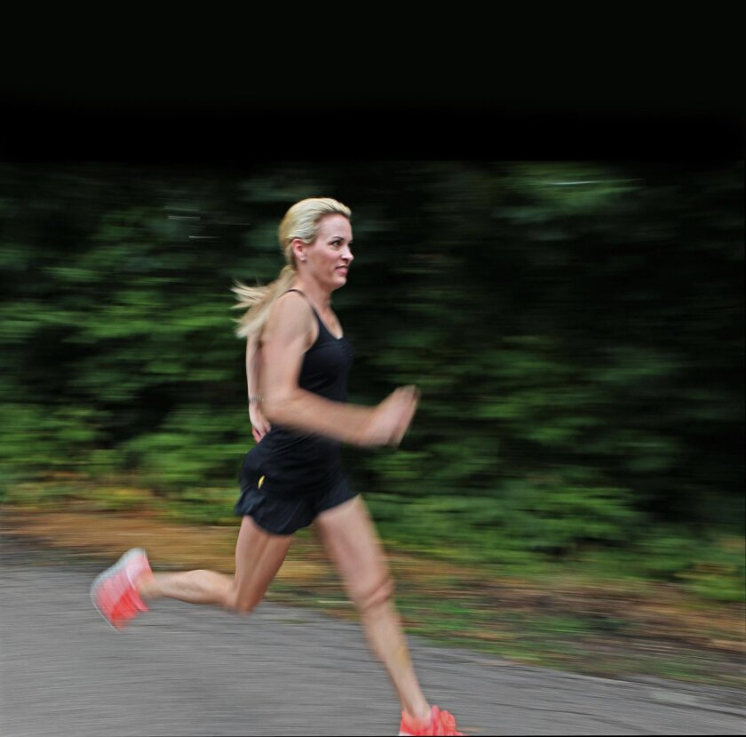 Suzy Favor Hamilton, 47, is running to help others with bipolar disorder. (AP Photo/Milwaukee Journal-Sentinel, Michael Sears)