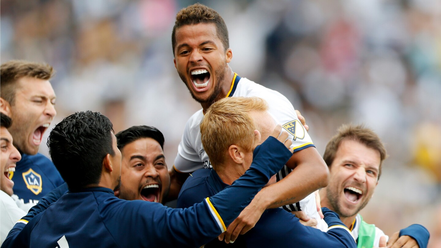 Galaxy forward Giovani dos Santos celebrates with teammates after scoring a goal against the Rapids.