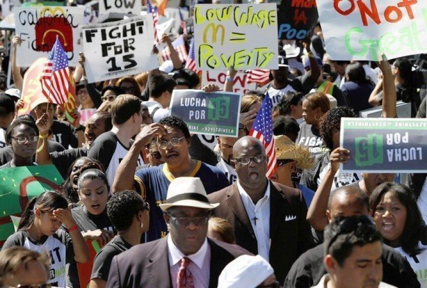 On California's legislative agenda: a possible increase in the minimum wage. Above, protesters in Los Angeles rally in support of a nationwide push by fast food workers seeking a $15-an-hour minimum wage and the right to unionize.