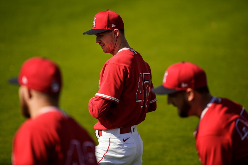Angels Griffin Canning (47) warms up with teammates during spring training at Tempe Diablo Stadium on Feb. 18 in Tempe, Ariz.