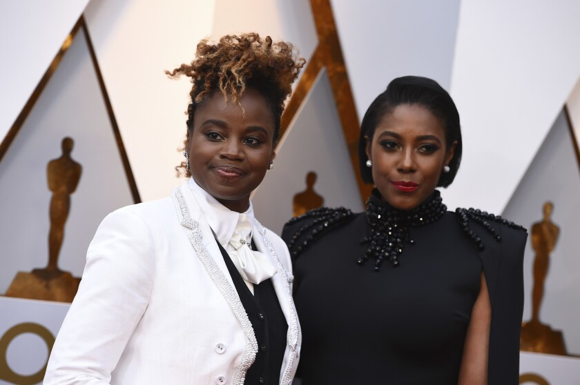 """Author Sarah M. Broom, left, and """"Mudbound"""" director Dee Rees arrive at the Oscars."""