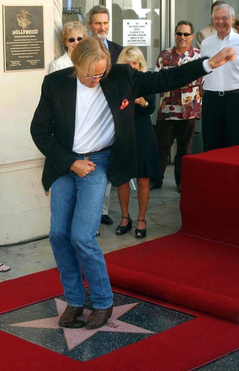 US actor and director Peter Fonda dances on his new star, the 2,241st star on the Hollywood Walk of Fame, in Hollywood, USA, 22 October 2003 (reissued 17 August 2019). EFE/EPA/Armando Arorizo/File