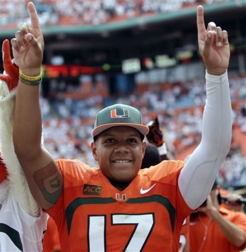 Miami quarterback Stephen Morris (17) acknowledges the fans after a 21-16 win against Florida during an NCAA football game, Saturday, Sept. 7, 2013, in Miami Gardens, Fla. (AP Photo/Alan Diaz)