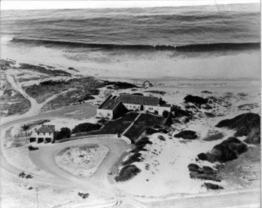 An aerial view of the Dunemere Drive home Philip Barber built in 1922, as it appeared then, when it was referred to as 'The Dunes.' Actor Cliff Robertson bought the home in 1963, added an addition by master architect Thomas Shepherd, and rechristening it 'Casa de la Paz.'  Courtesy La Jolla Histori