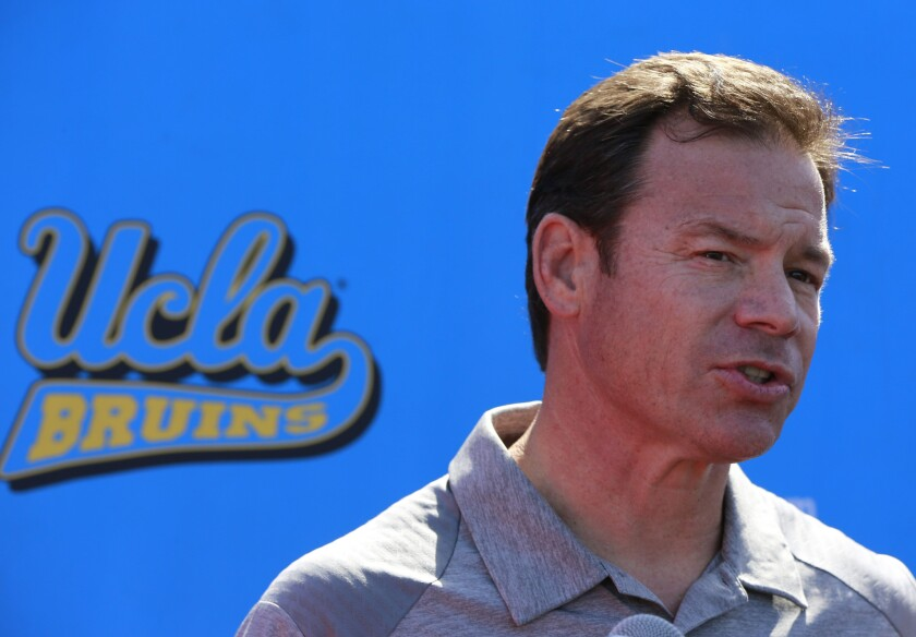 UCLA Coach Jim Mora speaks to reporters during the Bruins' annual NFL pro day on March 15.