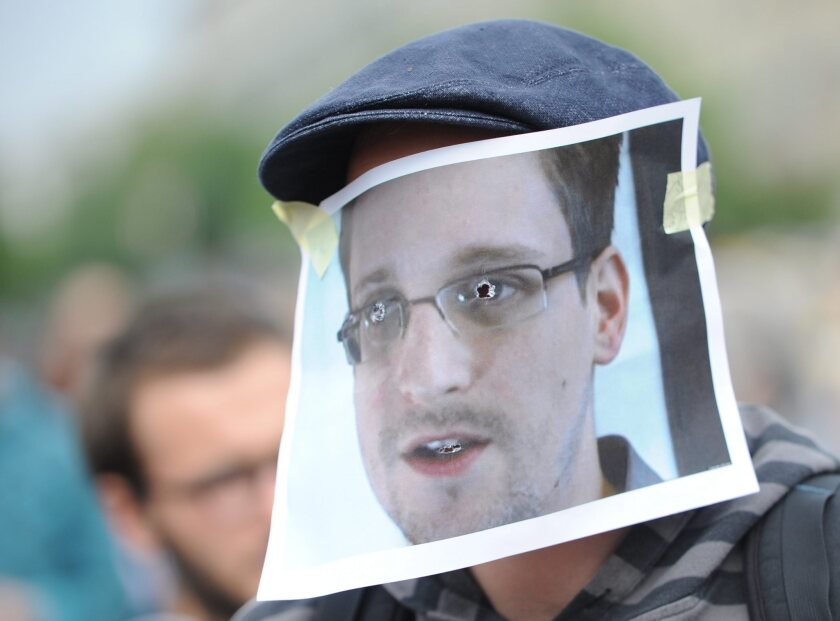Support among privacy advocates continues for fugitive NSA leaker Edward Snowden, as shown at this July 4 demonstration in front of Berlin's Brandenburg Gate. But Snowden's recent disclosure that he possesses thousands of highly sensitive documents that would harm U.S. national security if released has raised the stakes for countries that may be considering granting him asylum.