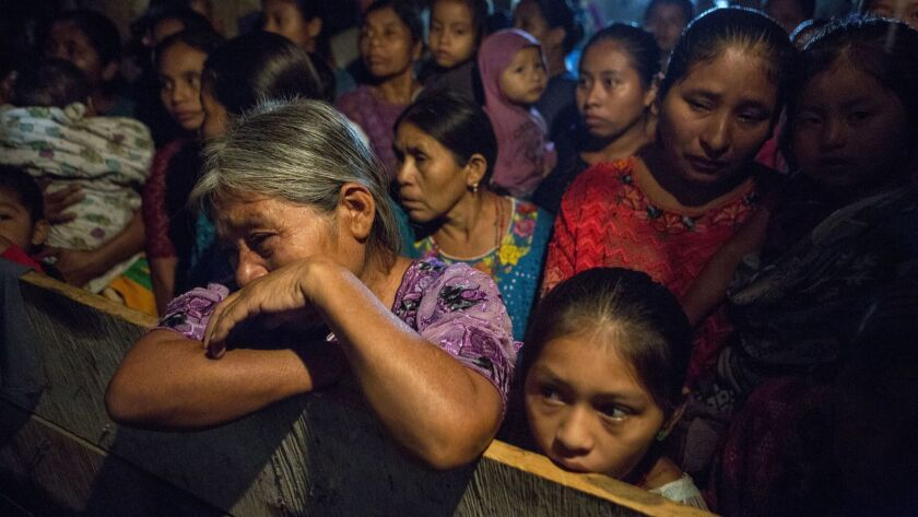 Elvira Choc grieves as she attends a memorial service for her 7-year-old granddaughter, Jakelin Caal, in San Antonio Secortez, Guatemala, on Dec. 24.