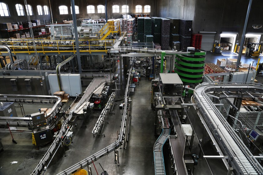 Trails of conveyor belts line a production room at Stone Brewery in Escondido.