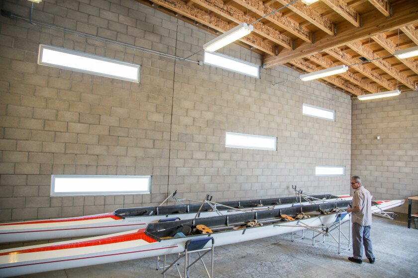 National City resident Joseph Leon observes the 40-foot row boats during Olympic Rowing Day on Saturday at the Aquatic Center.