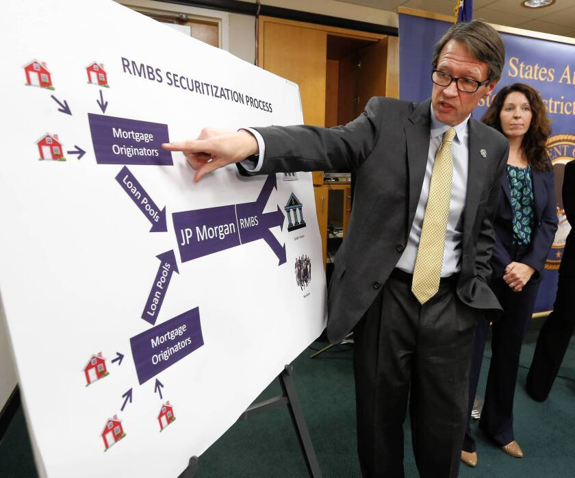 "U.S. Atty. Benjamin Wagner said the criminal probe of JPMorgan and its employees is ""active and ongoing."" Above, Wagner explains how mortgages were bundled at a news conference in Sacramento."