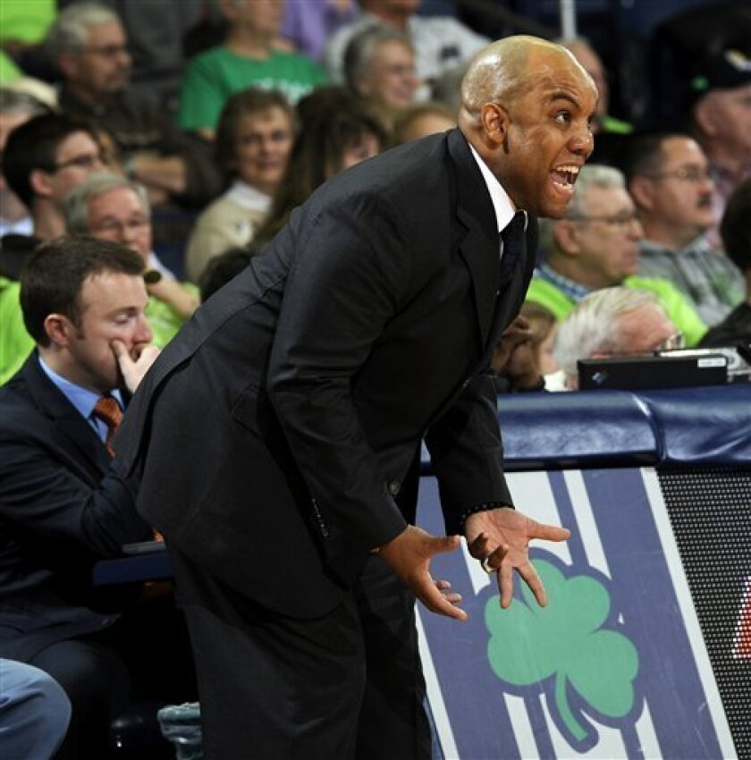 Syracuse coach Quentin Hillman shouts at his team during the first half of a NCAA college basketball game against Notre Dame Tuesday, Feb. 26, 2013 in South Bend, Ind. (AP Photo/Joe Raymond)