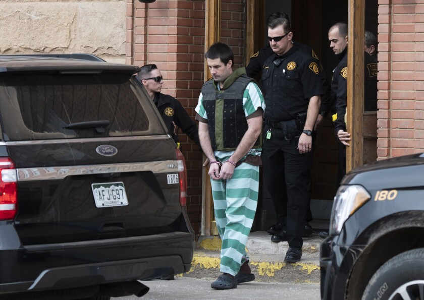 FILE - In this April 5, 2019 file photo Teller County Sheriff deputies lead Patrick Frazee out of the Teller County Courthouse in Cripple Creek, Colo. The trial of Frazee, charged with killing his fiancee and burning her body, is getting underway. Jury selection is scheduled to begin Monday Oct. 28. Frazee has pleaded not guilty to first-degree murder in the death of Kelsey Berreth. Her body hasn't been found despite searches at Frazee's ranch, her home and a landfill. (Christian Murdock/The Gazette via AP, File)