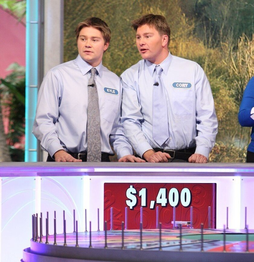 """Twins Kyle and Cory Miholich, two Carlsbad entrepreneurs, compete on """"Wheel of Fortune"""" in an episode airing Monday. (Sony Pictures Television)"""