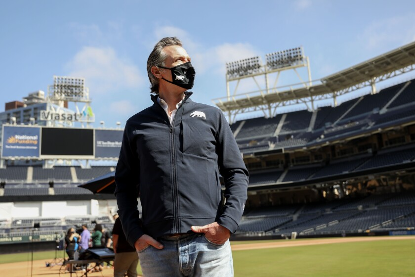 Gov. Gavin Newsom is shown at a news conference at Petco Park on Feb. 8.