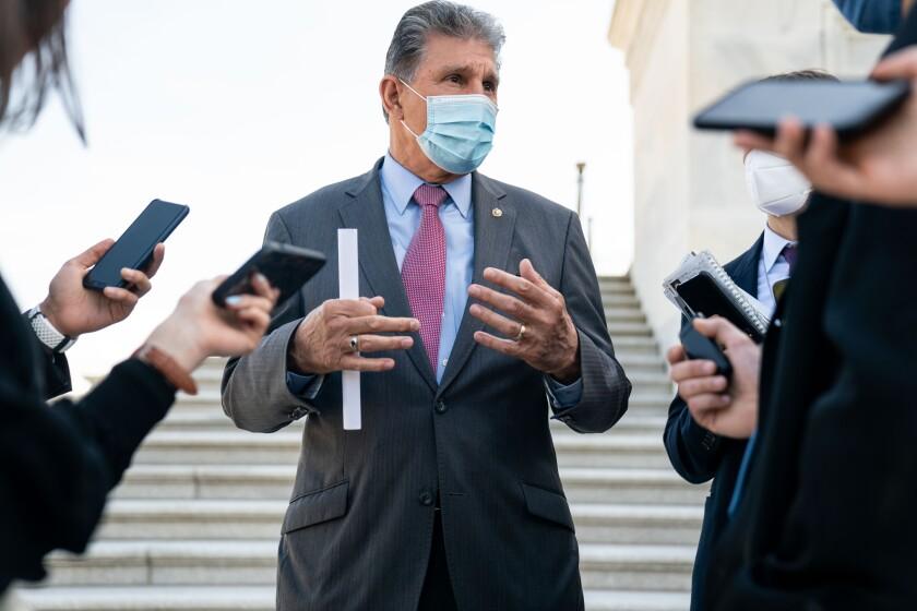 Sen. Joe Manchin speaks with reporters outside the U.S. Capitol on April 13.