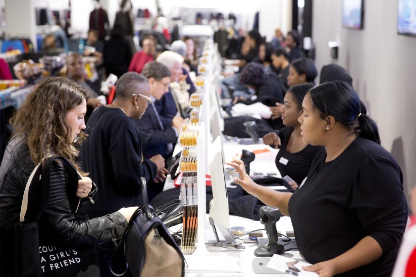 Customers pay for purchases at the Century 21 department store in Philadelphia on Oct . 28.