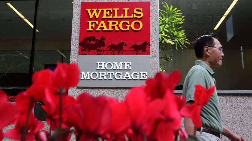 "A lawsuit alleges Wells Fargo ""would systematically attempt to charge or pass the rate lock expiration fees on to customers, even when the delay was not the customer's fault."""