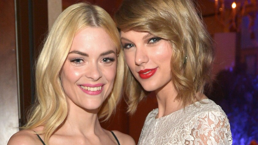 Jaime King, left, and Taylor Swift at the Weinstein Co.'s Oscar party in 2014. They'd first hit it off earlier that year at Weinstein's Golden Globes gathering.