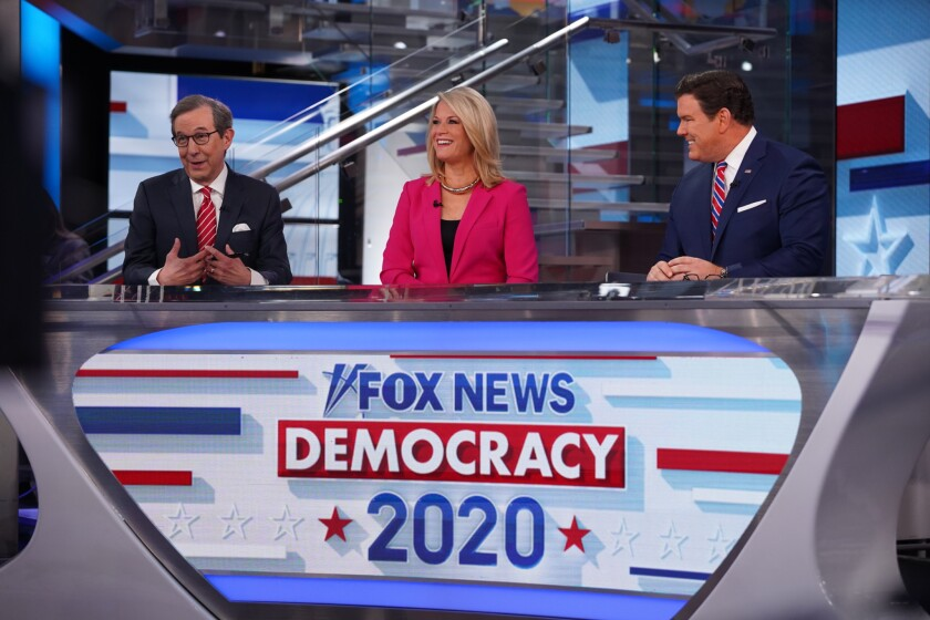 Chris Wallace with co-anchors Martha MacCallum and Bret Baier on the set of Fox News Channel's Super Tuesday coverage.