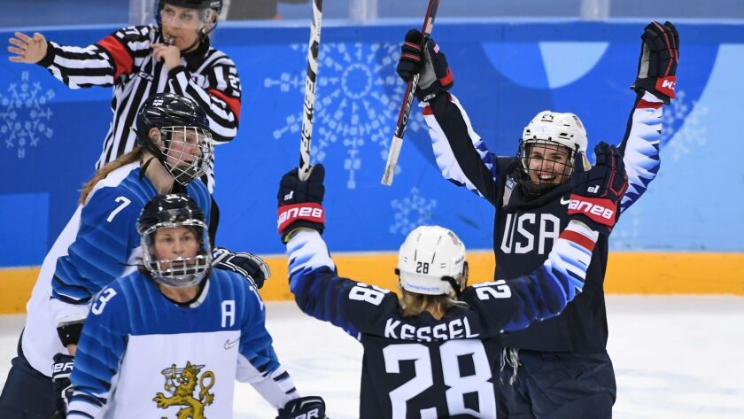 U.S. Danielle Cameranesi (R) celebrates after scoring a goal in the women's ice hockey semifinal game between the United States and Finland.